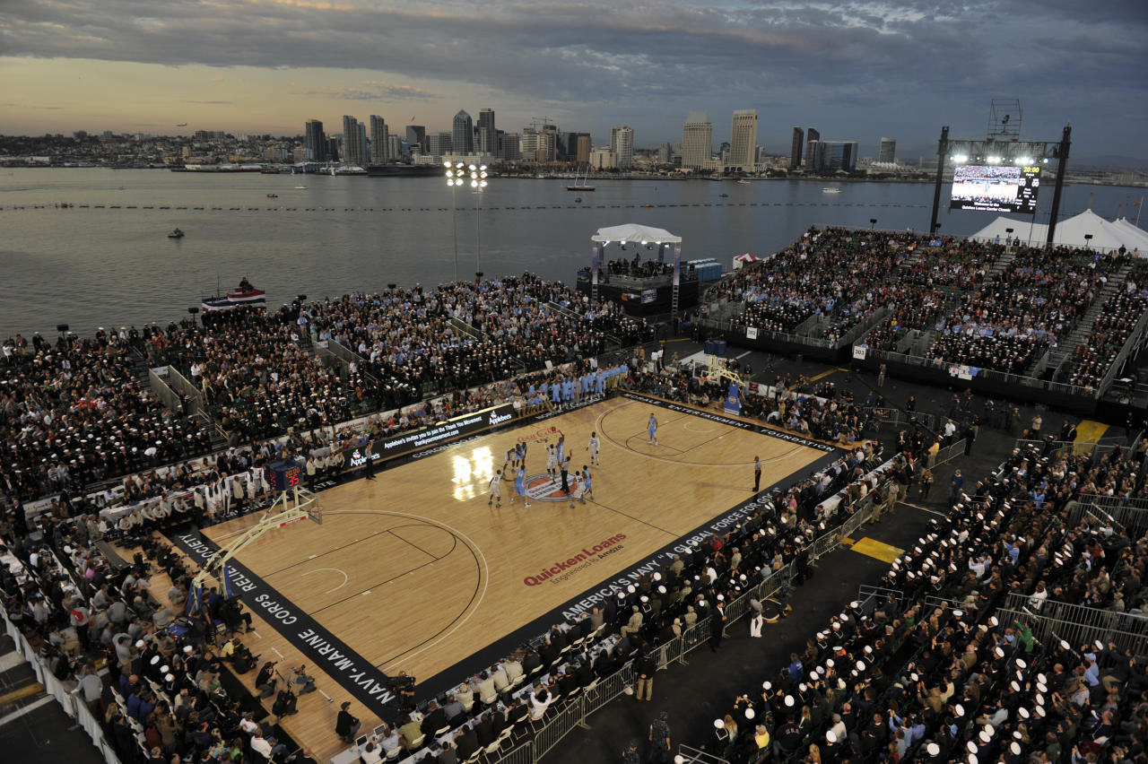 North Carolina and Michigan State tip off the first half of the Carrier Classic NCAA college basketball game on the flight deck aboard the USS Carl Vinson, Friday, Nov. 11, 2011, in Coronado, Calif. (AP Photo/U.S. Navy, Petty Officer 2nd Class James R. Evans)