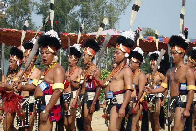 Hornbill Festival. Photo: Anurag Mallick & Priya Ganapathy - Held at Naga Heritage Village in Kisama, a permanent site 12km from Nagaland's capital, Kohima, the Hornbill Festival is the best place to catch all of the state's 16 tribes in one place. Ringing the arena are morungs (communal huts) of each tribe, where young boys once learnt stories on culture and folklore from elders of the host family who sat around a fireplace and sipped thutse (rice beer).