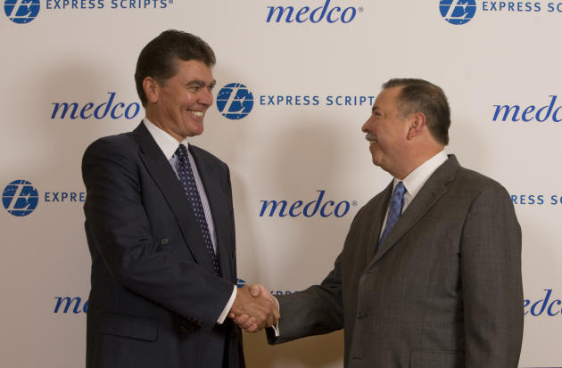 David Snow, CEO of Medco Health Solutions (L), and George Paz, CEO of Express Scripts, shake hands. (AP Photo/Express Scripts, Karen Elshout)