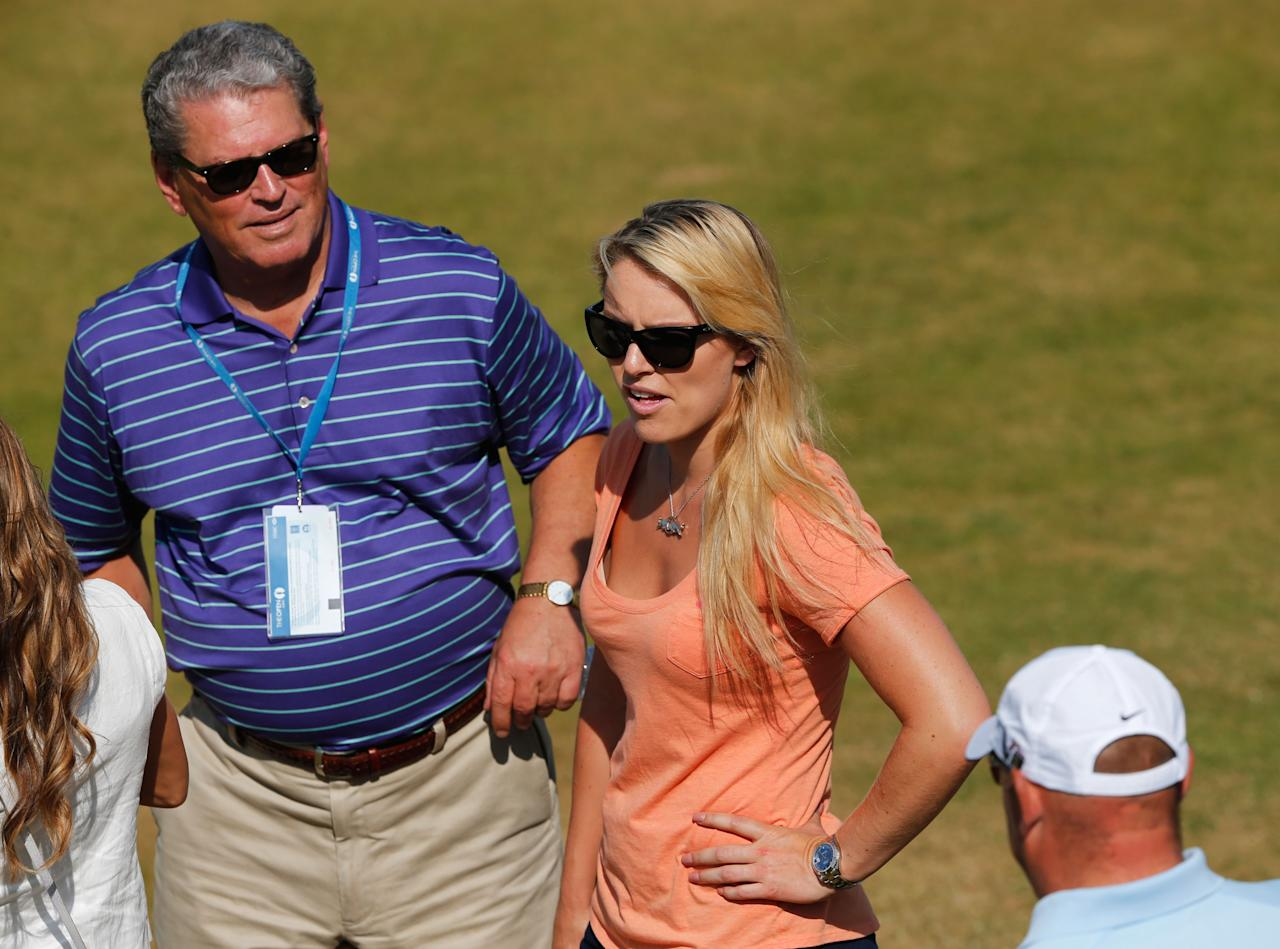 GULLANE, SCOTLAND - JULY 17: Skier Lindsey Vonn and her father Alan Kildow watch Tiger Woods of the United States ahead of the 142nd Open Championship at Muirfield on July 17, 2013 in Gullane, Scotland. (Photo by Rob Carr/Getty Images)