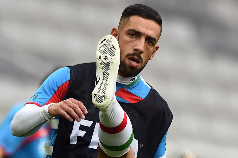Iran's forward Ashkan Dejagah stretches during a training session at the Baixada Arena in Curitiba, Brazil, on June 15, 2014, during the FIFA World Cup