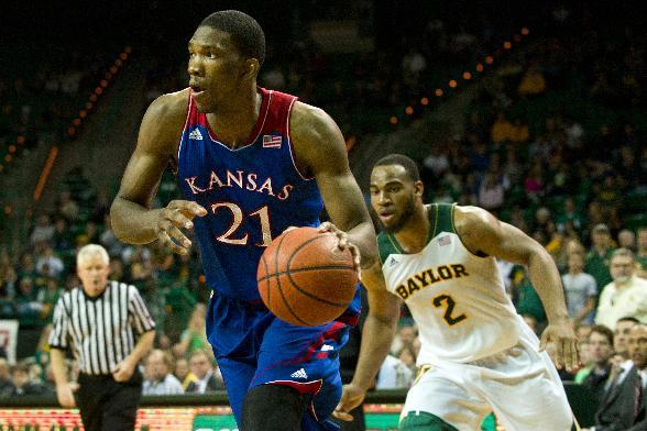 Joel Embiid of the Kansas Jayhawks drives to the basket against the Baylor Bears on February 4, 2014 at the Ferrell Center in Waco, Texas