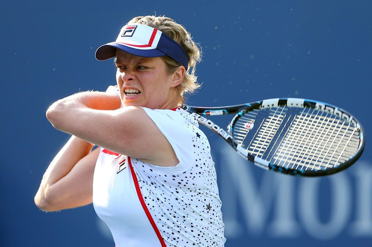 NEW YORK, NY - AUGUST 29:  Kim Clijsters of Belgium returns a shot against Laura Robson of Great Britain during their women's singles second round match Day Three of the 2012 US Open at USTA Billie Jean King National Tennis Center on August 29, 2012 in the Flushing neigborhood of the Queens borough of New York City.  (Photo by Cameron Spencer/Getty Images)