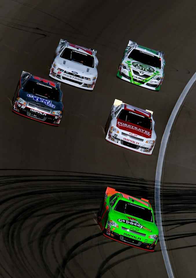 LAS VEGAS, NV - MARCH 10:  Danica Patrick, driver of the #7 GoDaddy.com Chevrolet, leads a pack of cars during the NASCAR Nationwide Series Sam's Town 300 at Las Vegas Motor Speedway on March 10, 2012 in Las Vegas, Nevada.  (Photo by Ronald Martinez/Getty Images for NASCAR)