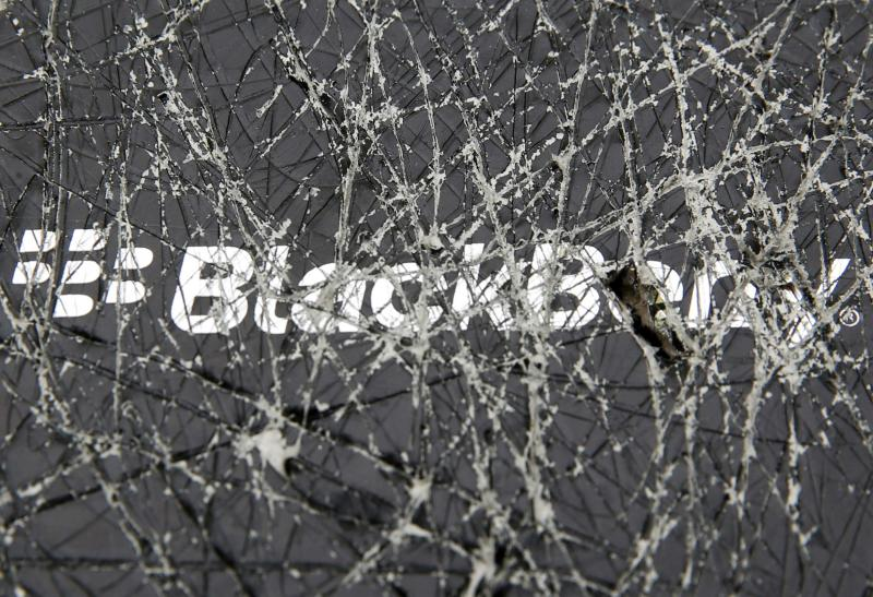 A Blackberry logo is seen through a cracked box in this photo illustration taken in Zenica