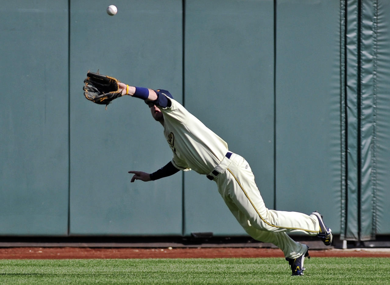 Kent State center fielder Evan Campbell leaps and catches a fly ball hit by Florida's Brian Johnson in the sixth inning of an NCAA College World Series elimination baseball game in Omaha, Neb., Monday, June 18, 2012. (AP Photo/Eric Francis)