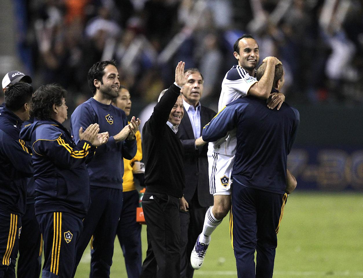 Los Angeles Galaxy forward Landon Donovan, second from right, celebrates after scoring on a penalty kick during the second half of the second game of an MLS soccer Western Conference semifinal against the New York Red Bulls at Home Depot Center in Carson, Calif., Thursday, Nov. 3, 2011. The Galaxy won 2-1. (AP Photo/Jae Hong)