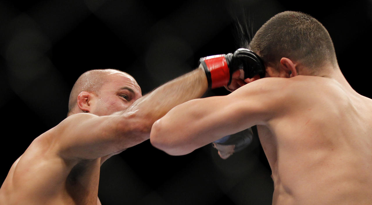 BJ Penn, left, punches Nick Diaz during a mixed martial arts welterweight bout, Saturday, Oct. 29, 2011, in Las Vegas. Diaz won by unanimous decision. (AP Photo/Isaac Brekken)
