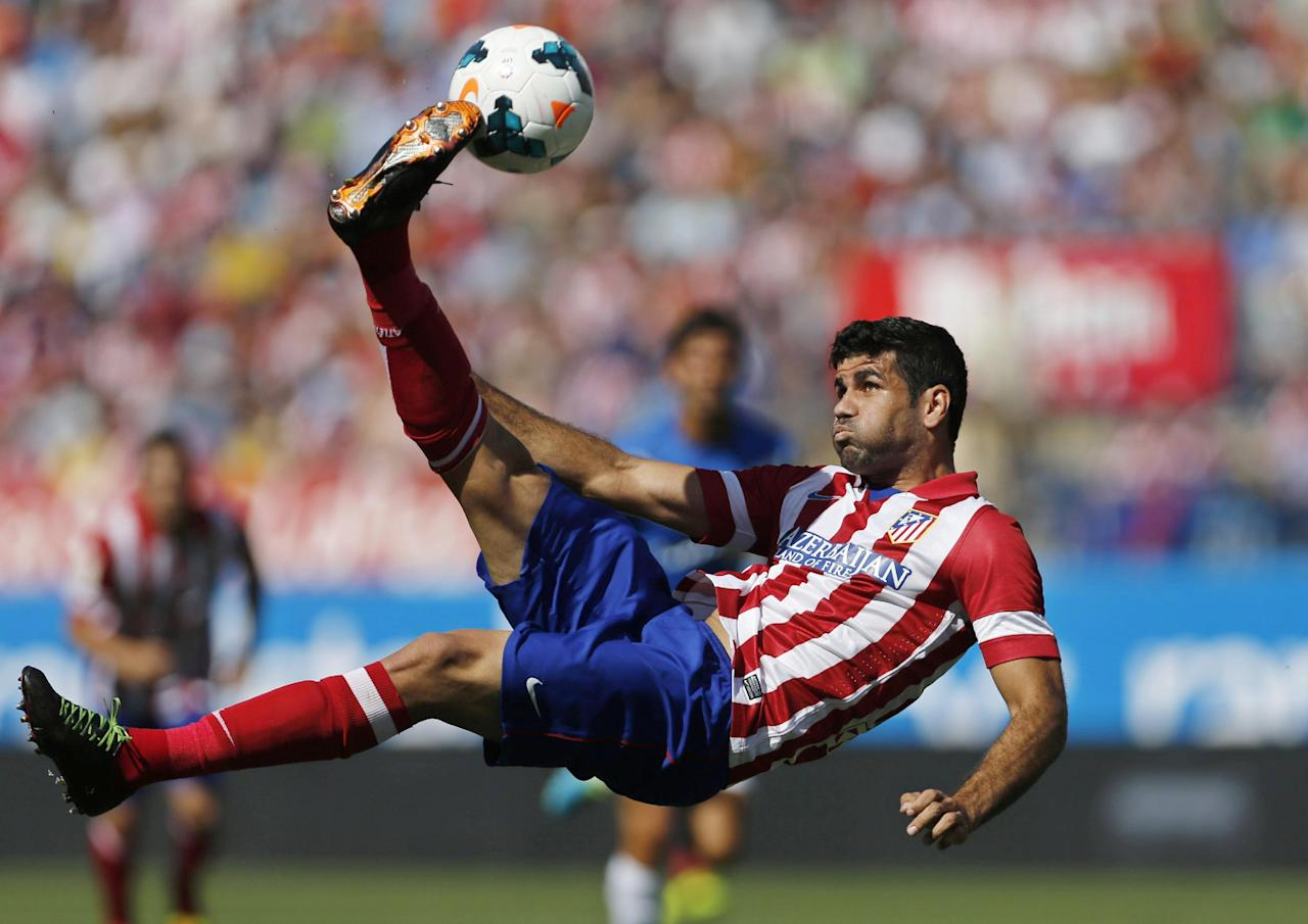 FILE - In this Sept. 14, 2013 file photo, Atletico de Madrid's Diego Costa tries an overhead kick on goal during a Spanish La Liga soccer match against Almeria at the Vicente Calderon stadium in Madrid. Costa has sent a letter to the Brazilian football federation and FIFA it was announced Tuesday Oct. 29, 2013 saying his intention is to play for his adopted Spain. Costa was born in Brazil but holds a Spanish passport. He has not played an official match for Brazil, leaving him free to declare his allegiance with his adopted country. The Spanish federation says national coach Vicente del Bosque plans to select Costa for friendlies in Angola on Nov. 15 and in South Africa on Nov. 19. (AP Photo/Paul White, File)