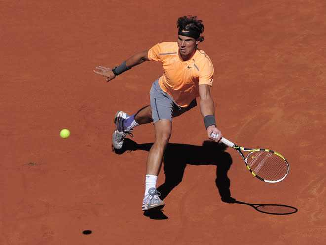 Rafael Nadal of Spain returns the ball to compatriot David Ferrer during the final match of the Barcelona Open tennis tournament Conde de Godo on April 29, 2012, in Barcelona. Nadal won 6-2, 6-4.  AFP PHOTO / JOSEP LAGOJOSEP LAGO/AFP/GettyImages