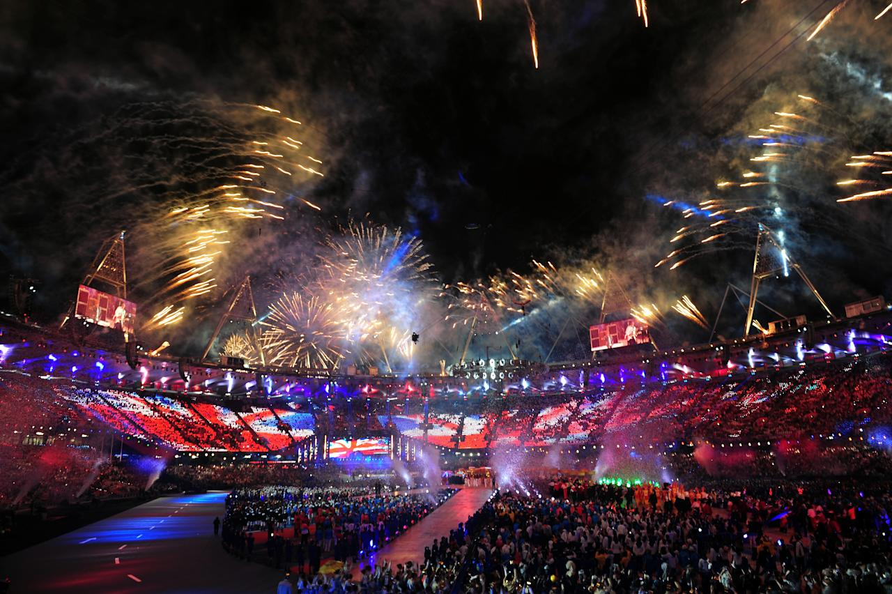 LONDON, ENGLAND - AUGUST 12:  Fireworks explode over the stadium during the Closing Ceremony on Day 16 of the London 2012 Olympic Games at Olympic Stadium on August 12, 2012 in London, England.  (Photo by Mike Hewitt/Getty Images)