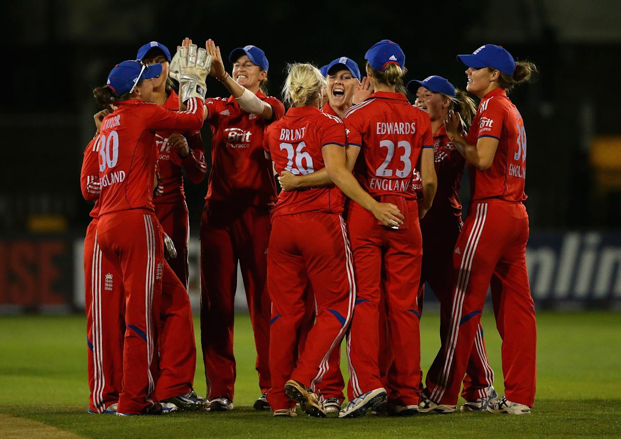 CHELMSFORD, ENGLAND - AUGUST 27:  England players celebrate after defeating Australia during the 1st NatWest T20 match between England Women and Australia Womens at Ford County Ground on August 27, 2013 in Chelmsford, England.  (Photo by Julian Finney/Getty Images)