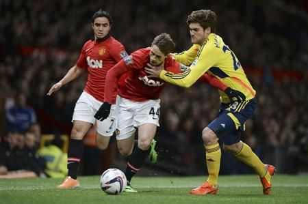 Manchester United's Januzaj challenges Sunderland's Alonso during their English League Cup semi-final second leg soccer match at Old Trafford in Manchester, northern England