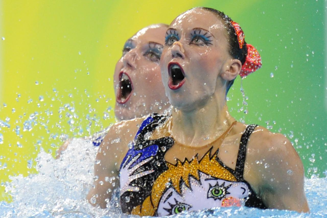 Russia's Svetlana Romashina and Natalia Ishchenko compete in the final of the duets free synchronised swimming competition in the FINA World Championships at the indoor stadium of the Oriental Sports Centre in Shanghai on July 22, 2011. Romashina and Ishchenko won gold.  AFP PHOTO / FRANCOIS XAVIER MARIT (Photo credit should read FRANCOIS XAVIER MARIT/AFP/Getty Images)