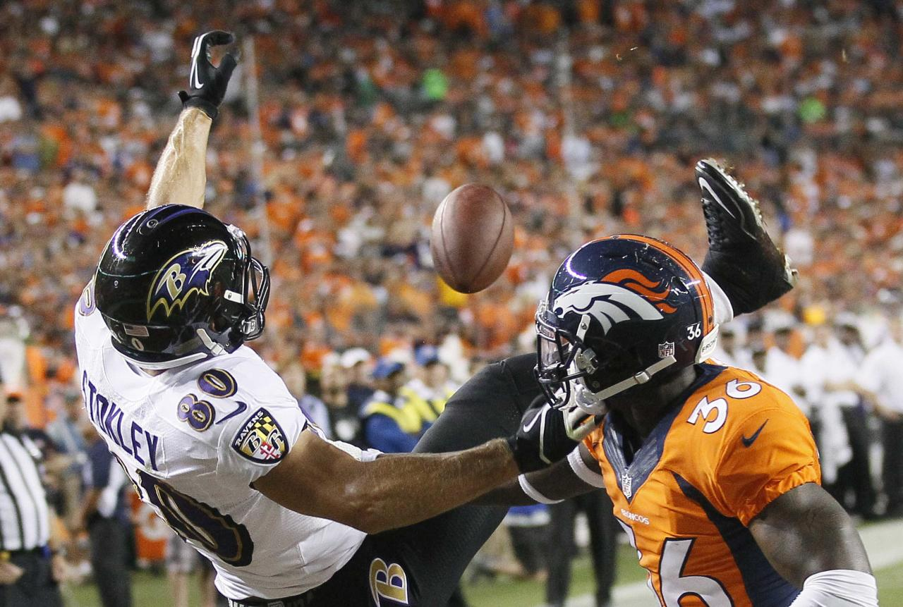 Denver Broncos cornerback Kayvon Webster (R) breaks up a pass to Baltimore Ravens Brandon Stokley in the endzone in the second quarter of their NFL football game in Denver September 5, 2013. REUTERS/Rick Wilking (UNITED STATES - Tags: SPORT FOOTBALL)