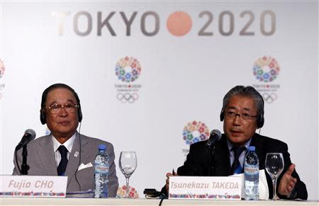 Japan Olympic Committee President Tsunekazu Takeda speaks next to Toyota chairman Fujio Cho during a news conference in support of the Tokyo 2020 summer Olympics candidacy in Buenos Aires