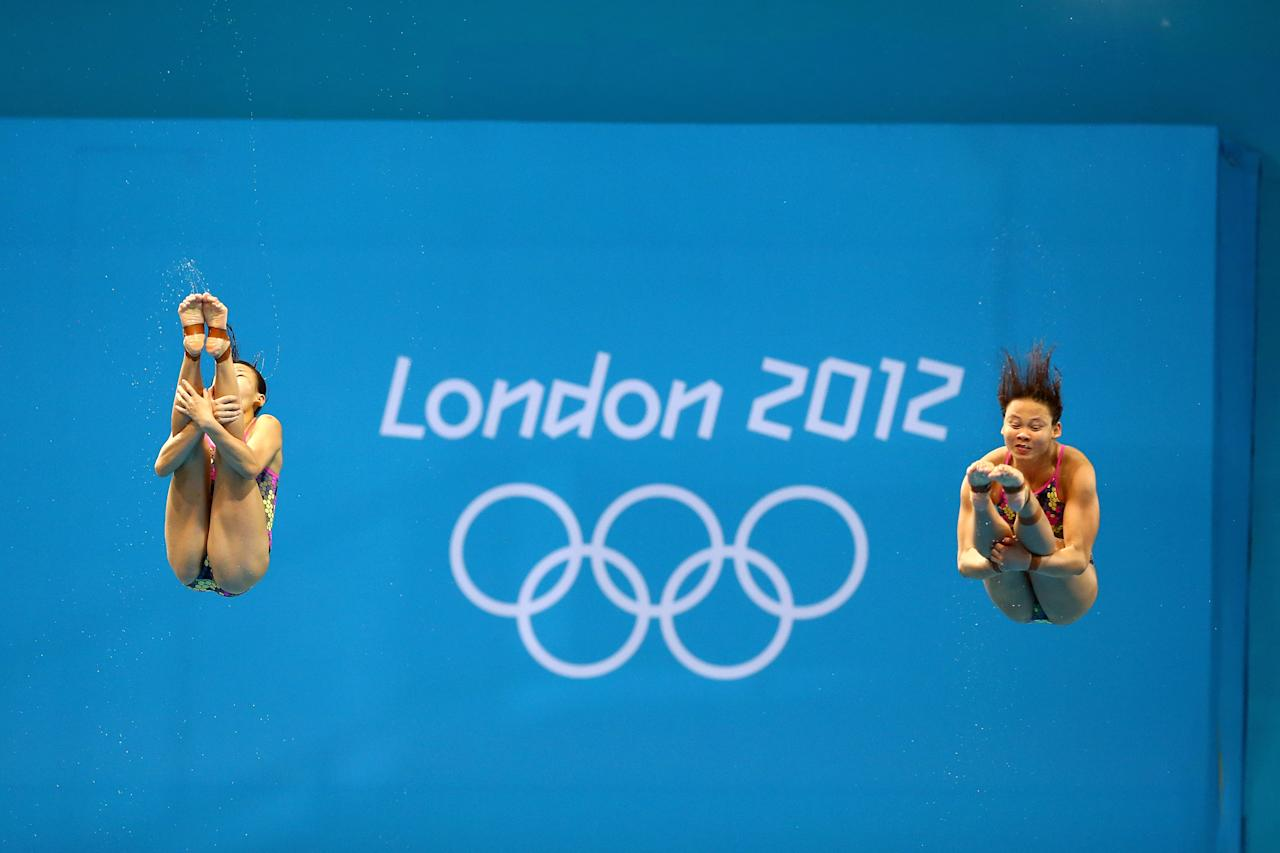 LONDON, ENGLAND - JULY 29:  Pandelela Rinong Pamg and Jun Hoong Cheong of Malaysia compete in the Women's Synchronised 3m Springboard final on Day 2 of the London 2012 Olympic Games at the Aquatics Centre at Aquatics Centre on July 29, 2012 in London, England.  (Photo by Al Bello/Getty Images)