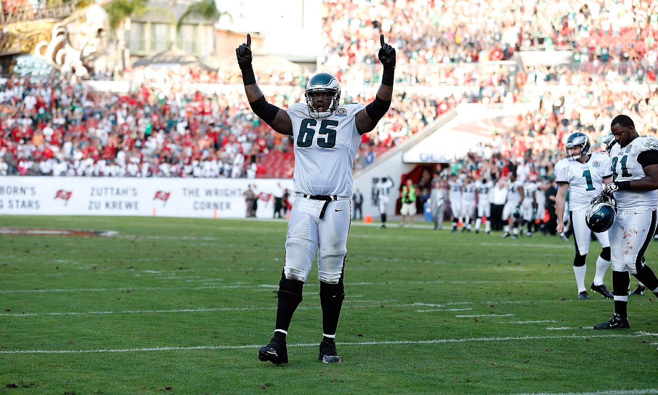 TAMPA, FL - DECEMBER 09:  Left tackle King Dunlap #65 of the Philadelphia Eagles celebrates the winning touchdown against the Tampa Bay Buccaneers during the game at Raymond James Stadium on December 9, 2012 in Tampa, Florida.  (Photo by J. Meric/Getty Images)