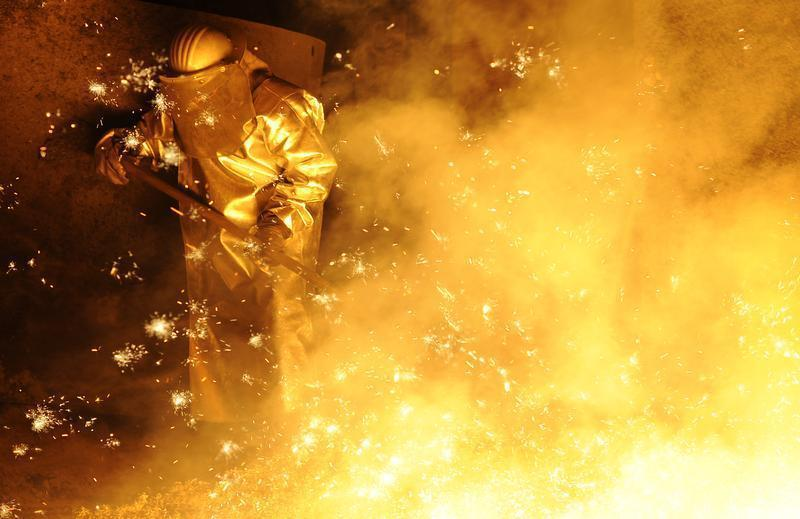 A steel-worker is pictured at a furnace at the plant of German steel company Salzgitter AG in Salzgitter.