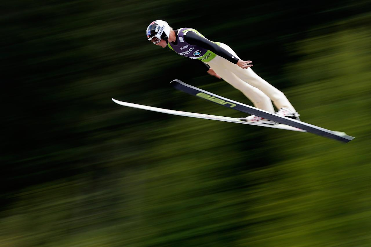 COURCHEVEL, FRANCE - AUGUST 15: Mackenzie Boyd-Clowes of Canada competes in the 1st round of the FIS Ski Jumping Grand Prix Mens Large Hill Individual Final on August 15, 2013 in Courchevel, France. (Photo by Dean Mouhtaropoulos/Getty Images)