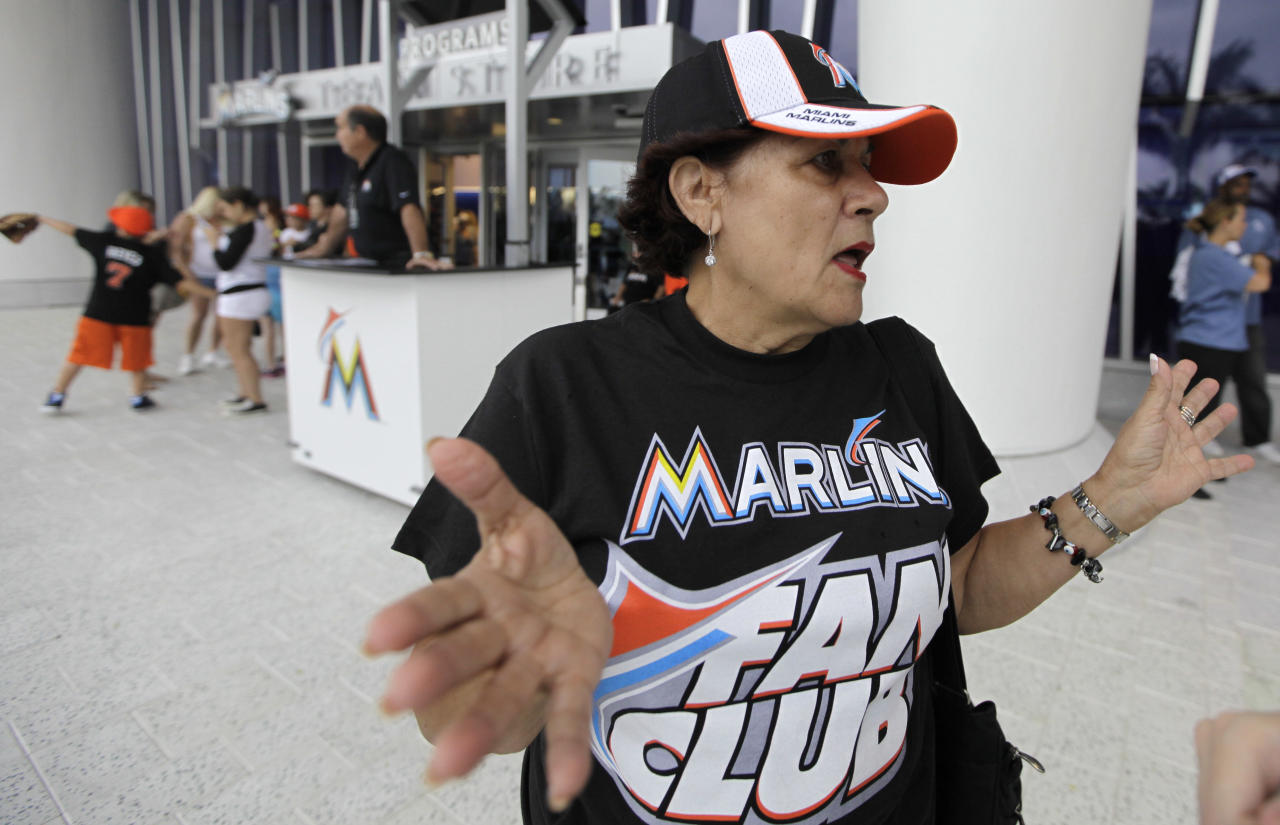 Cuban American Nancy Azcuy, of Hialeah, Fla., stands outside of Marlins Park before a baseball game between the Miami Marlins and Houston Astros, Friday, April 13, 2012, in Miami. Azcuy is a season ticket holder, but was offended by remarks made by manager Ozzie Guillen in which he expressed admiration for Cuban leader Fidel Castro. She is in support of Guillen losing his job. Guillen was suspended for five games. (AP Photo/Lynne Sladky)