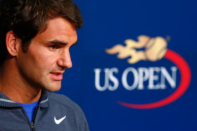 Roger Federer makes his 2014 U.S. Open entrance Tuesday night. (Photo by Julian Finney/Getty Images)