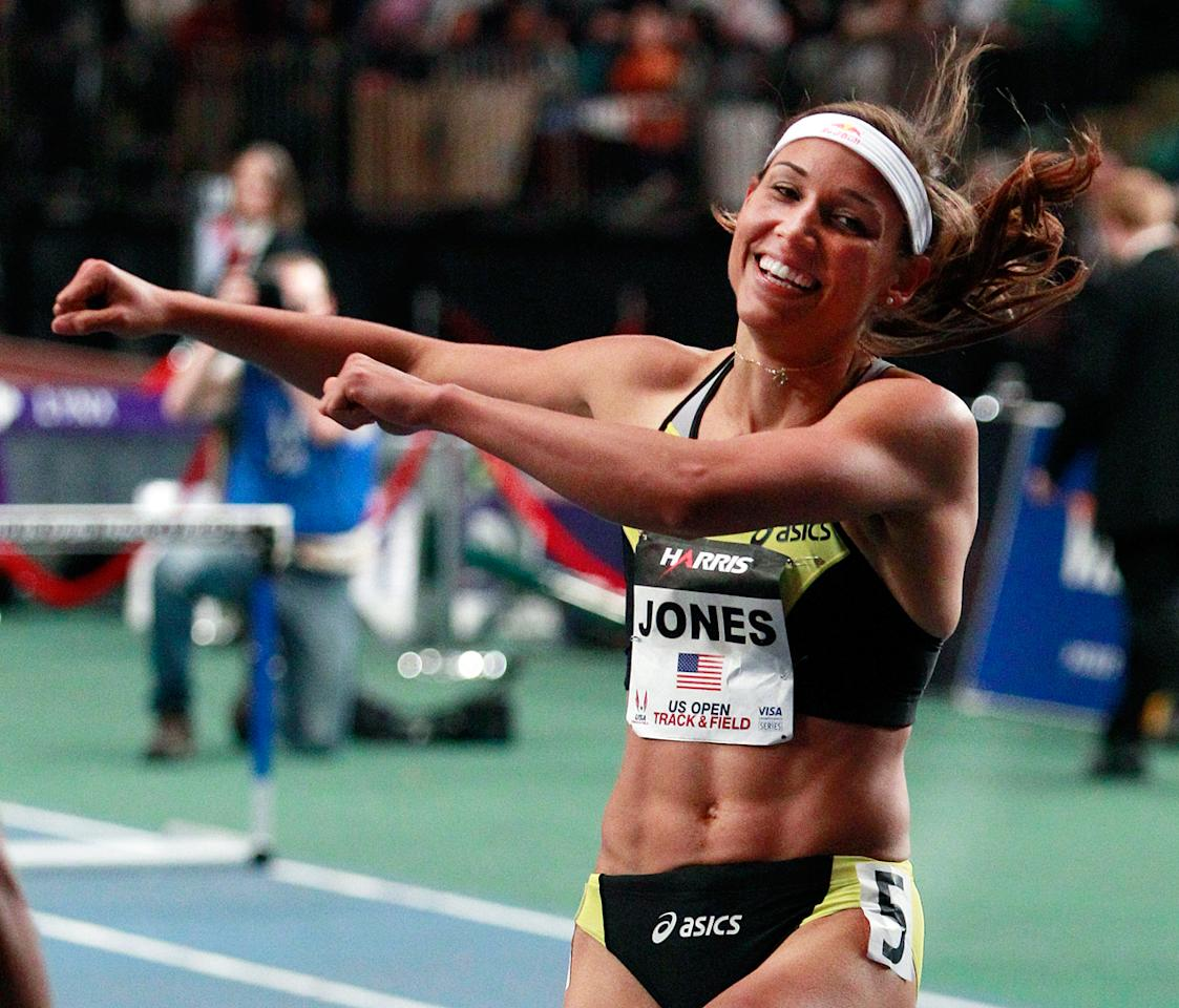 Lolo Jones reacts after winning the women's 50-meter hurdles with a time of 6.78 seconds at the U.S. Open Indoor athletic meet on Saturday, Jan. 28, 2012, in New York.