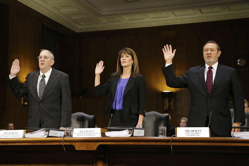 Caterpillar Inc former Senior International Tax Manager Perkins, Vice President for Finance Services Lagacy and Chief Tax Officer Beran are sworn in to testify at hearing on Caterpillar's offshore tax strategy on Capitol Hill in Washington
