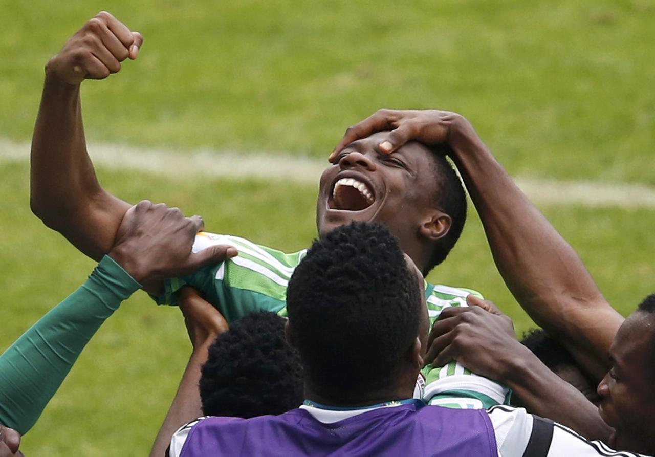 Nigeria's Ahmed Musa celebrates after scoring his second goal against Argentina during their 2014 World Cup Group F soccer match at the Beira Rio stadium in Porto Alegre June 25, 2014. REUTERS/Marko Djurica (BRAZIL - Tags: SOCCER SPORT WORLD CUP)