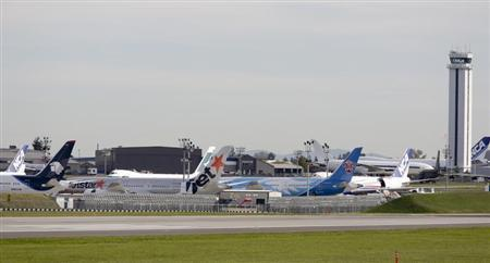 Several Boeing 787 Dreamliner aircraft are seen parked at Paine Field Airport in Everett, Washington