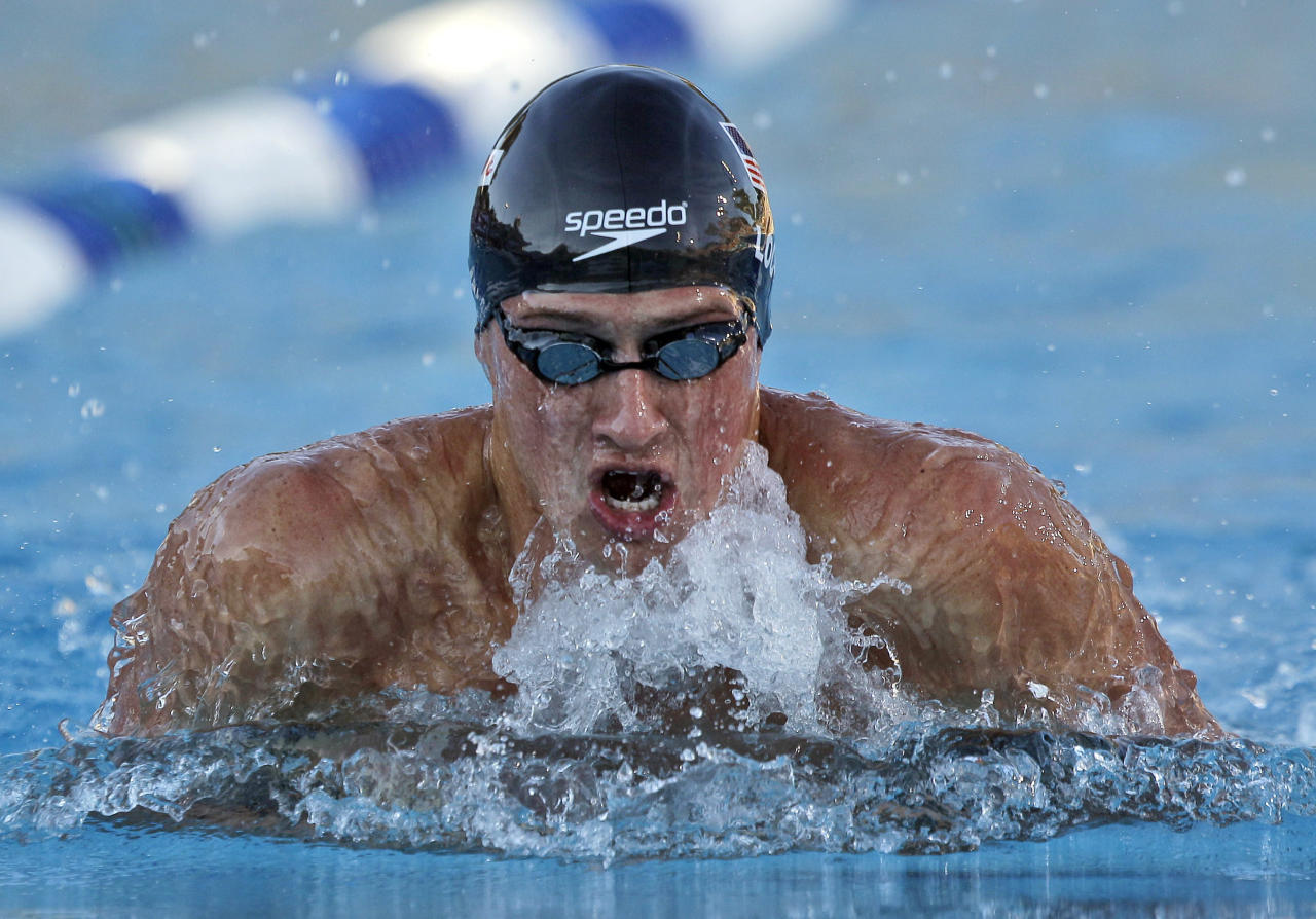 Ryan Lochte competes in the 100 breaststroke during the U.S. national swimming championships in Stanford, Calif., Tuesday, Aug. 2, 2011. (AP Photo/Marcio Jose Sanchez)