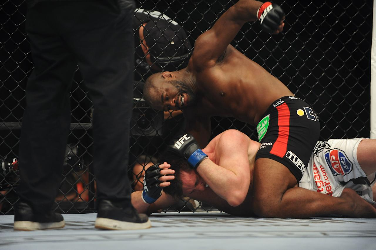 Rashad Evans [top] hasn't fought since beating Chael Sonnen [bottom] via TKO in late 2013. (Stephen R. Sylvanie-USA TODAY Sports)