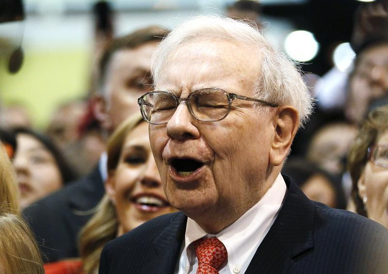 Berkshire Hathaway Chairman Buffett reacts at a newspaper throwing competition before the company's annual meeting in Omaha