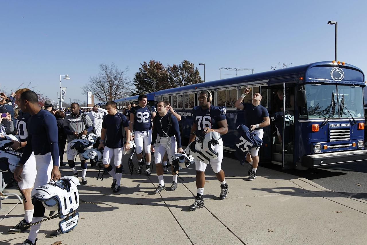 The Penn State team arrives at Beaver Stadium before their game with the University of Nebraska Saturday, Nov. 12, 2011 in State College, Pa. Penn State is playing for the first time in decades without former head coach Joe Paterno, after he was fired in the wake of a child sex abuse scandal involving a former assistant coach. (AP Photo/Alex Brandon)