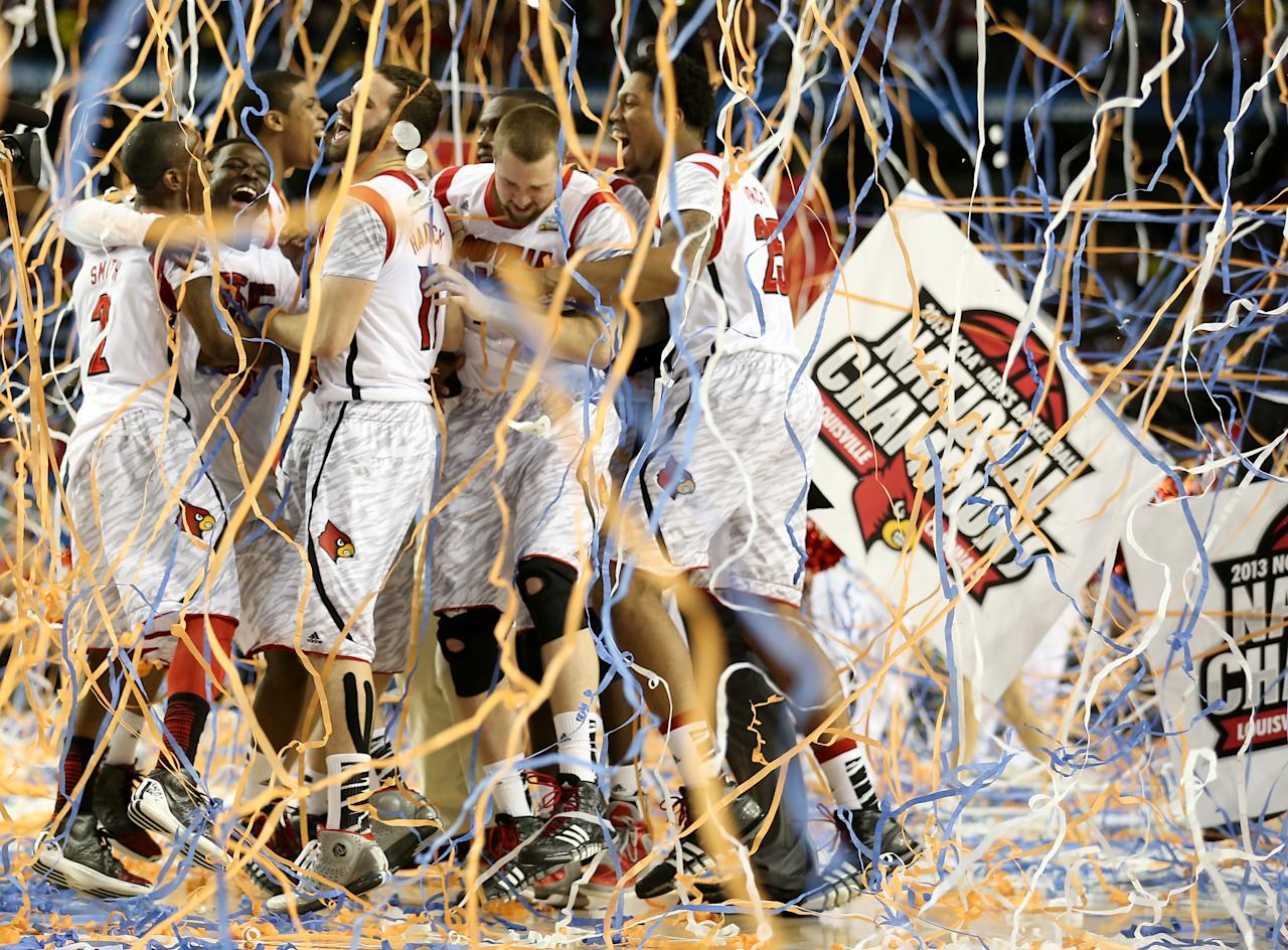 The Louisville Cardinals celebrate after they won 82-76 against the Michigan Wolverines during the 2013 NCAA Men's Final Four Championship at the Georgia Dome on April 8, 2013 in Atlanta, Georgia.  (Photo by Andy Lyons/Getty Images)