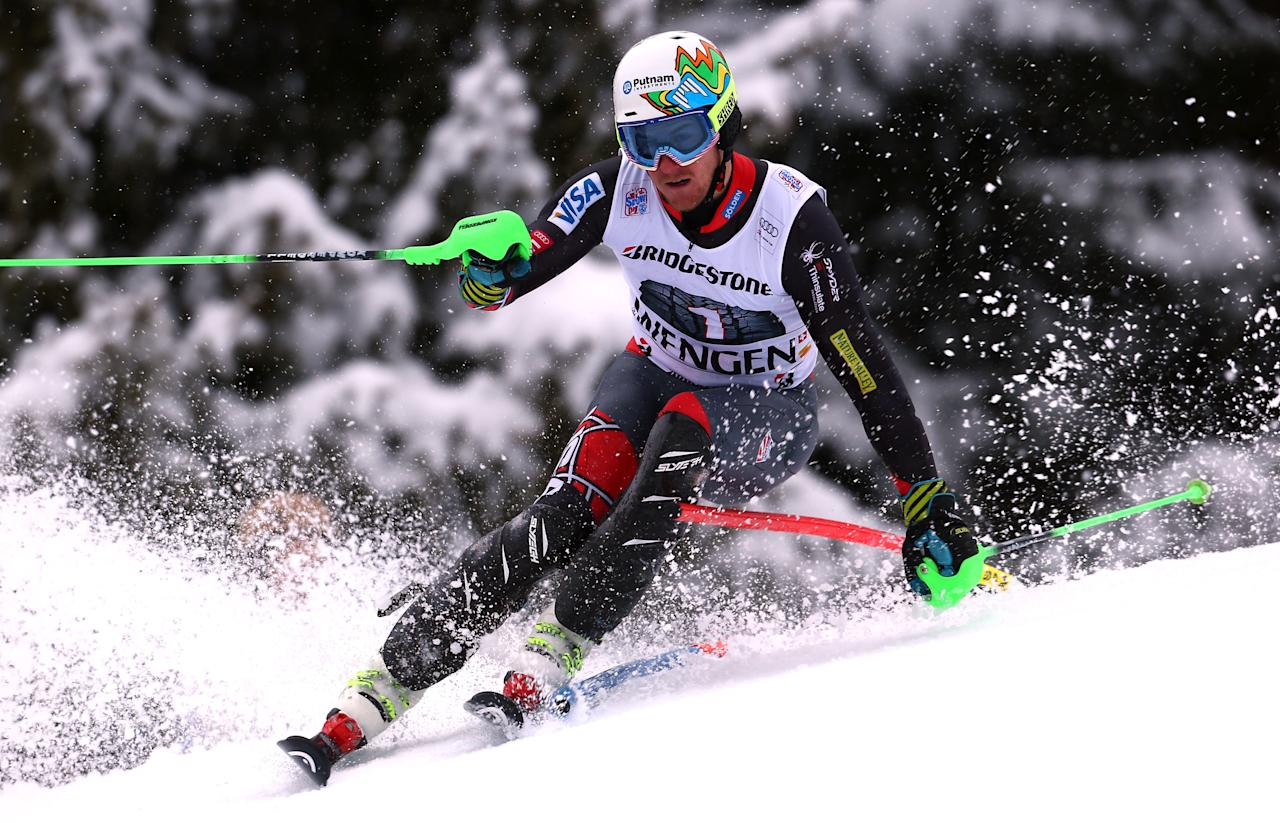 Ted Ligety, of the US, clears a gate during a slalom portion of a men's alpine ski World Cup super-combined event, in Wengen, Switzerland, Friday, Jan. 17, 2014. (AP Photo/Alessandro Trovati)