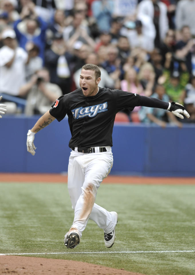 TORONTO, CANADA - SEPTEMBER 05:  Brett Lawrie #13 of the Toronto Blue Jays celebrates his bottom of the 11th inning walk off home run during MLB game action against the Boston Red Sox September 5, 2011 at Rogers Centre in Toronto, Ontario, Canada. (Photo by Brad White/Getty Images)