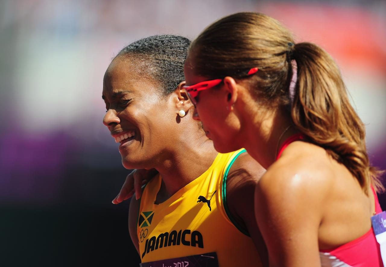 LONDON, ENGLAND - AUGUST 06:  Brigitte Foster-Hylton of Jamaica reacts with Lolo Jones of the United States after competing in the Women's 100m Hurdles heat on Day 10 of the London 2012 Olympic Games at the Olympic Stadium on August 6, 2012 in London, England.  (Photo by Stu Forster/Getty Images)