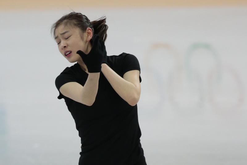 Kim Yuna of South Korea skates at the figure skating practice rink at the 2014 Winter Olympics, Friday, Feb. 14, 2014, in Sochi, Russia