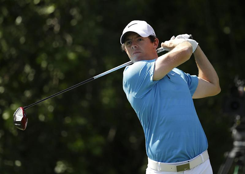 Rory McIlroy, of Northern Ireland, tees off on the third hole during the final round of the Honda Classic golf tournament, Sunday, March 2, 2014, in Palm Beach Gardens, Fla