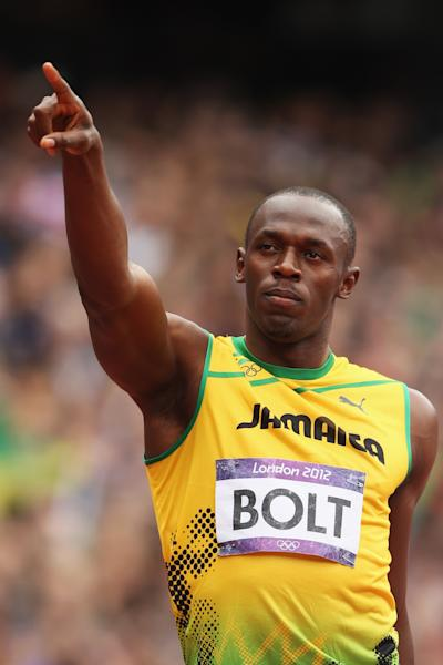 Usain Bolt reacts after competing in the Men's 200m Round 1 Heats in London. (Getty Images)