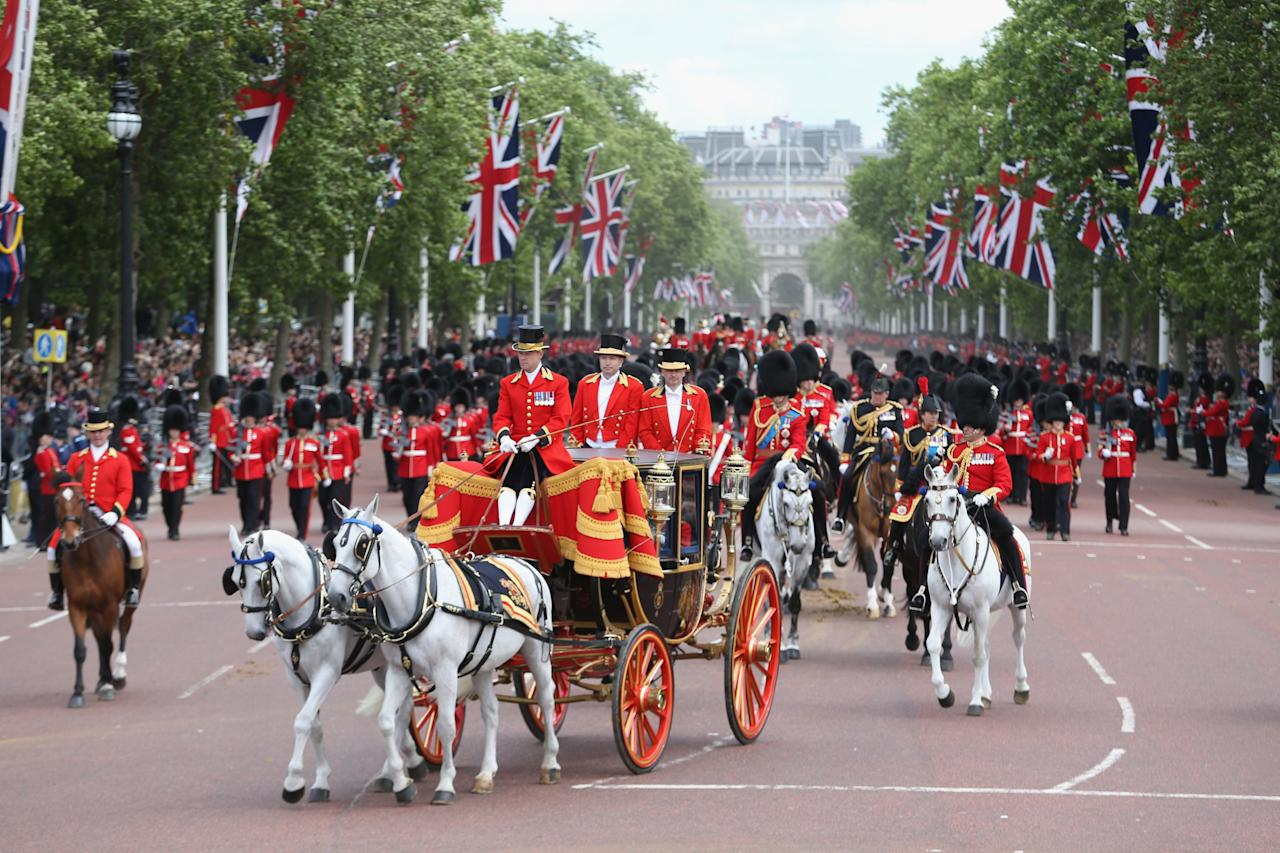 LONDON, ENGLAND - JUNE 15: Queen Elizabeth II makes her way back towards Buckingham Palace during the annual Trooping the Colour Ceremony on June 15, 2013 in London, England. Today's ceremony which marks the Queens official birthday will not be attended by Prince Philip the Duke of Edinburgh as he recuperates from abdominal surgery and will also be The Duchess of Cambridge's last public engagement before her baby is due to be born next month.  (Photo by Chris Jackson/Getty Images)