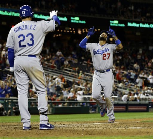 Dodgers beat Nationals 7-6 for split of DH