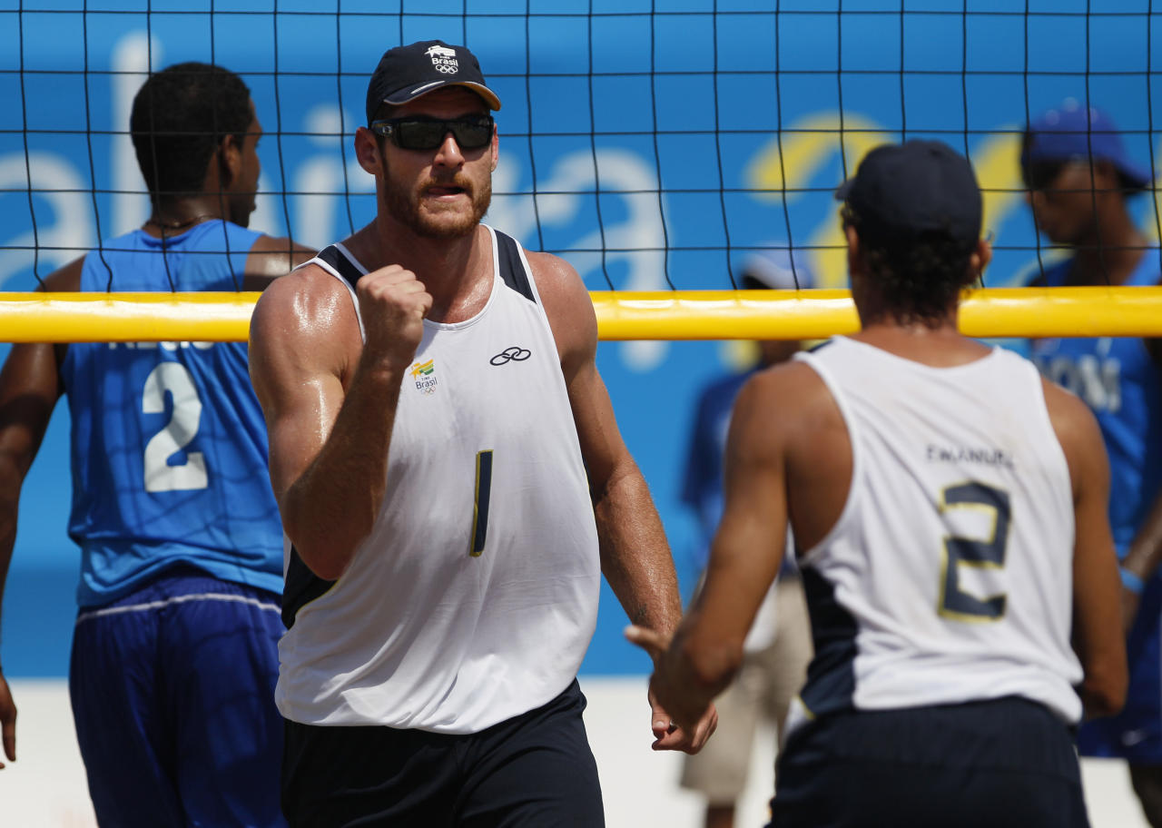 Brazil's Emanuel Rego, left, celebrates a point during a men's beach volleyball match against the Dominican Republic at the Pan American Games in Puerto Vallarta, Mexico, Wednesday Oct. 19, 2011. (AP Photo/Ariana Cubillos)