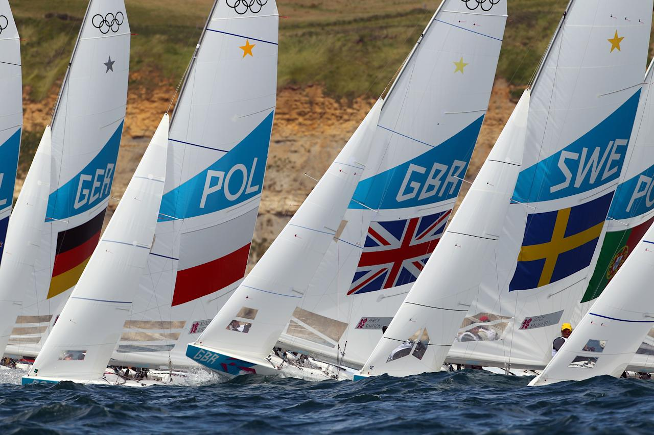 WEYMOUTH, ENGLAND - JULY 29: Iain Percy and Andrew Simpson of Great Britain in action during the Star class race at the London 2012 Olympic Games at the Weymouth & Portland Venue at Weymouth Harbour on July 29, 2012 in Weymouth, England.  (Photo by Richard Langdon/Getty Images)