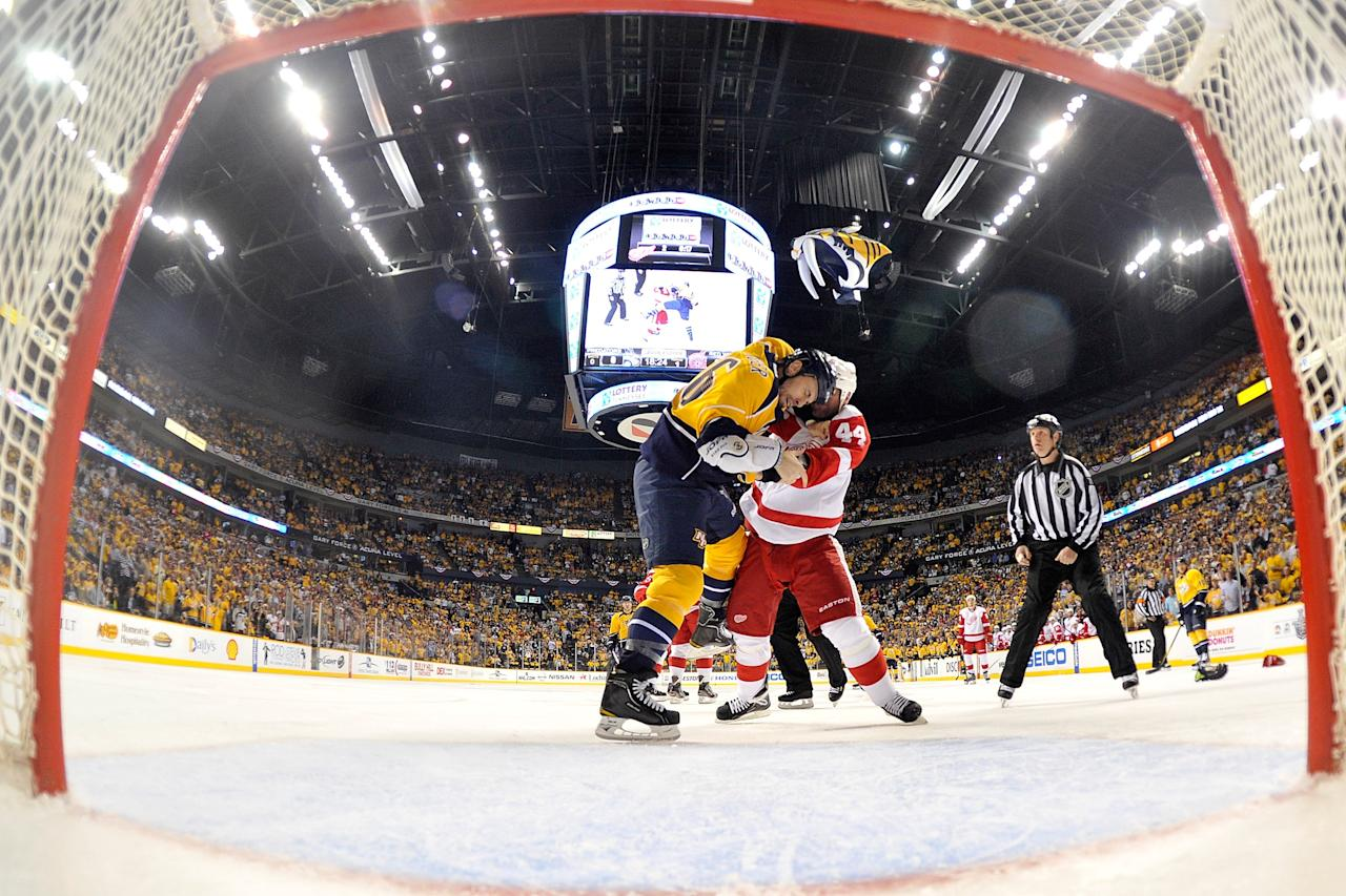 NASHVILLE, TN - APRIL 13: Todd Bertuzzi #44 of the Detroit Red Wings and Shea Weber #6 of the Nashville Predators fight in Game Two of the Western Conference Quarterfinals during the 2012 NHL Stanley Cup Playoffs at the Bridgestone Arena on April 13, 2012 in Nashville, Tennessee.  (Photo by Frederick Breedon/Getty Images)
