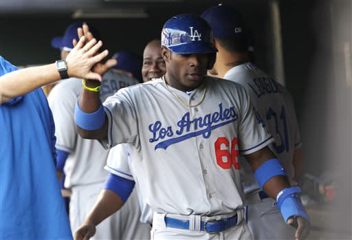 Ramirez lifts Dodgers to 10-8 win over Rockies