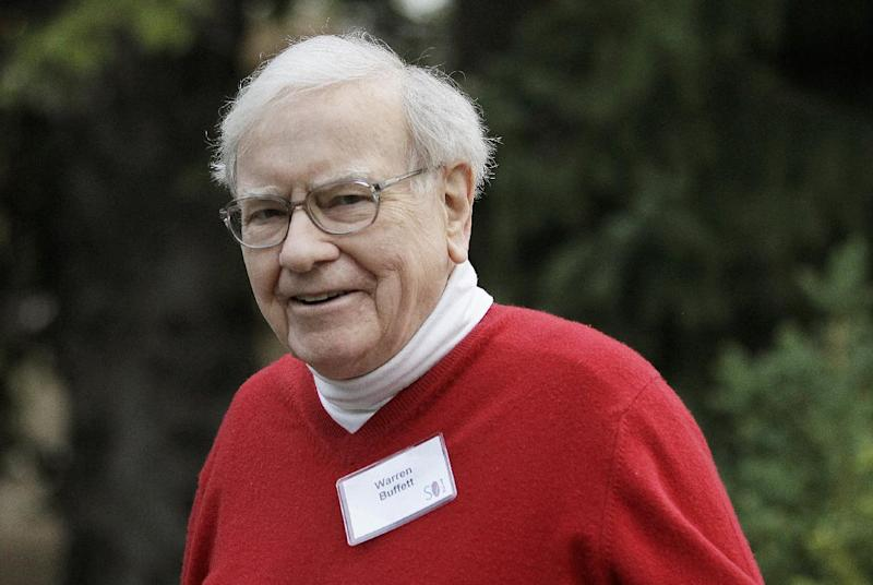 Warren Buffett, chairman and CEO, Berkshire Hathaway, Inc., arrives at the Allen & Company Sun Valley Conference in Sun Valley, Idaho, Friday, July 13, 2012. Buffett remains happiest while hunting for deals like the $23.3 billion acquisition of the maker of Heinz ketchup his company announced Thursday, Feb. 14, 2013, it will be helping finance.  So Berkshire shareholders can set aside the idea that the Buffett, 82, might retire someday even if he did undergo prostate cancer treatment last summer. Buffett enjoys what he does as Berkshire's chairman and CEO far too much.(AP Photo/Paul Sakuma, File)