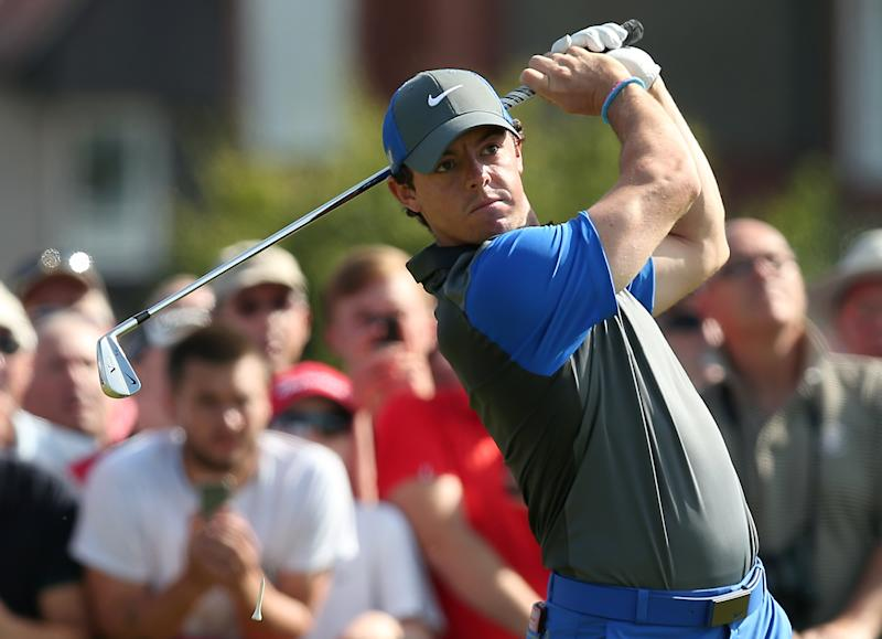 Rory McIlroy tees off on the opening day of the British Open Golf Championship in Hoylake, north-west England on July 17, 2014