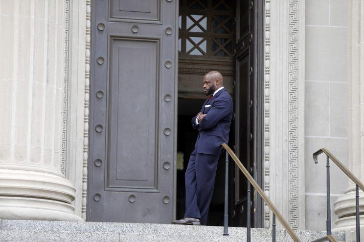 John Fuller, attorney for Cardell Hayes, stands outside the Orleans Parish Criminal District Court. (AP)